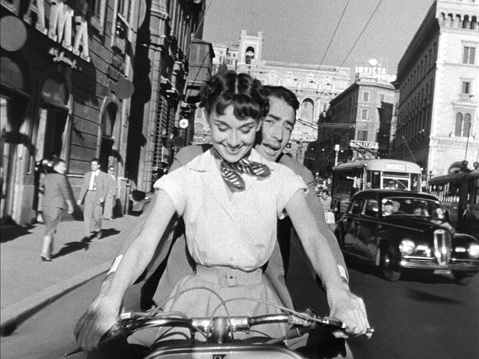 960px-Audrey_Hepburn_and_Gregory_Peck_on_Vespa_in_Roman_Holiday_trailer.jpg